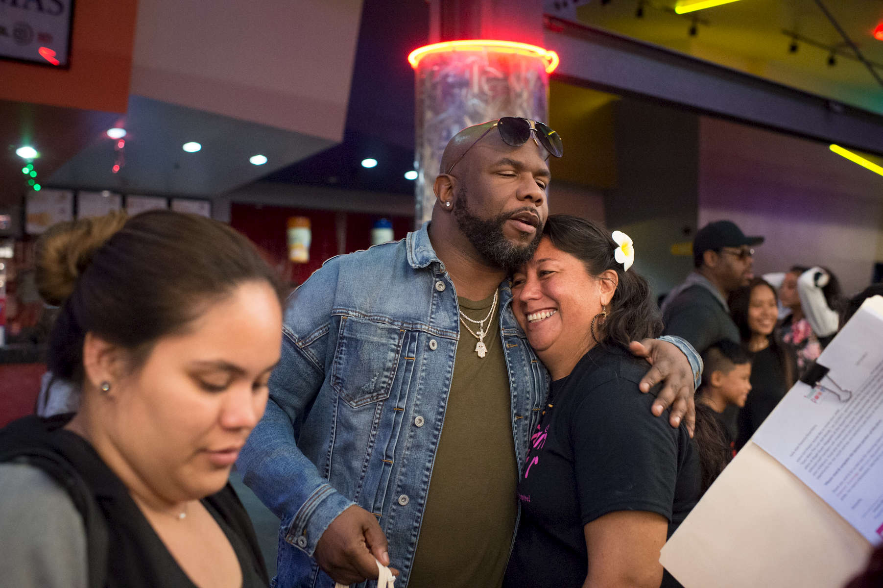 A Boyz II Men fan gets a hug from band member Wanya Morris after an evening showing of Star Wars: The Last Jedi at the Guam Premiere Outlets movie theater in Tamuning. (Dec. 14, 2017)Photo by Nancy Borowick