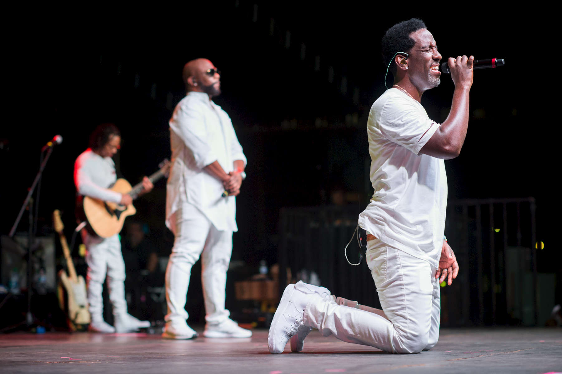 On bended knee, Boyz II Men singer Shawn Stockman performed for the audience with one sweet melody at the Paseo Stadium in Hagatna, Guam.  (Dec. 15, 2017)Photo by Nancy Borowick