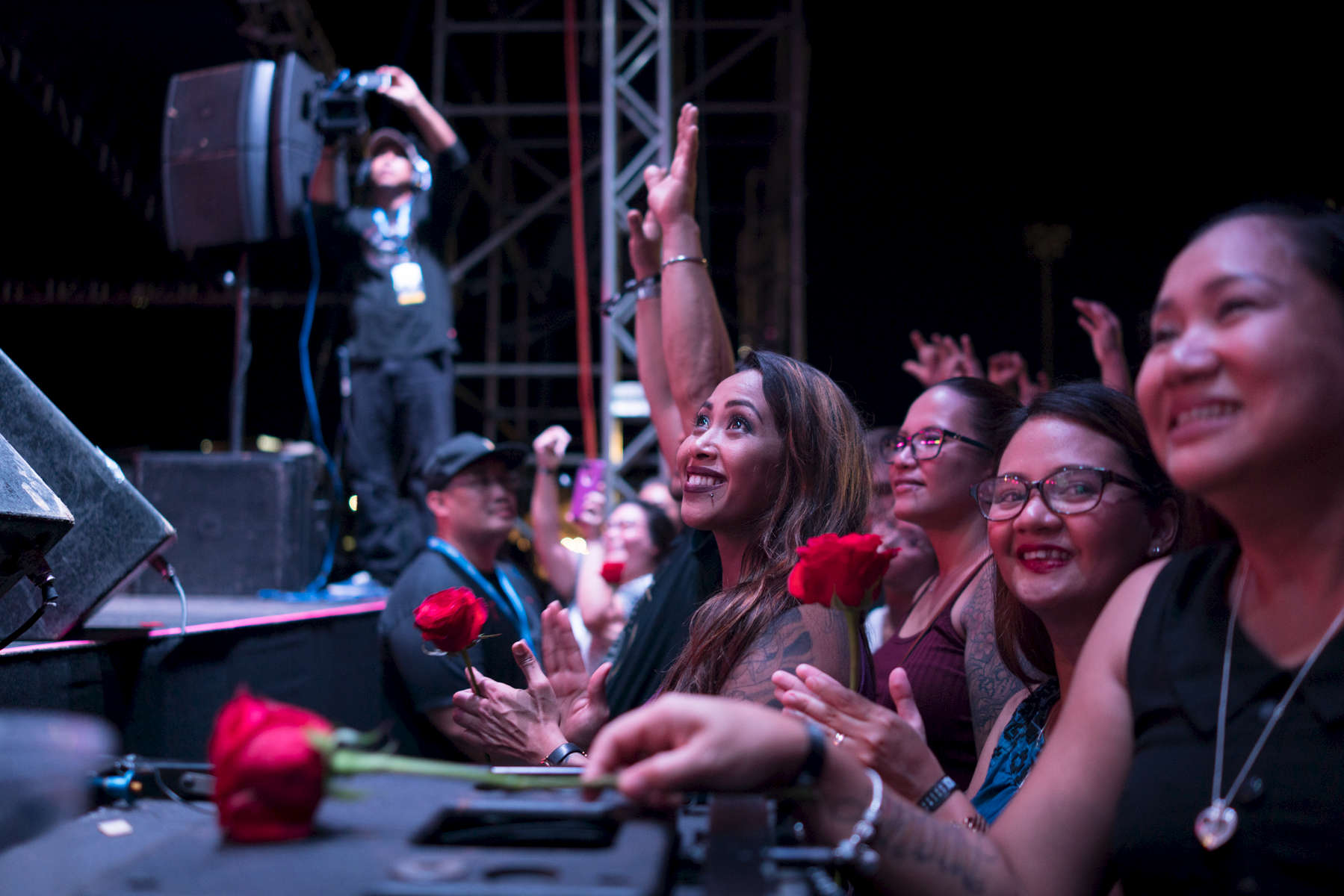"Tonight was just Guam's night, as the Boyz II Men serenaded the audience at the Paseo Stadium with their classic hit, ""I'll Make Love To You,"" while handing out red roses to ladies in the front row.  (Dec. 15, 2017)Photo by Nancy Borowick"