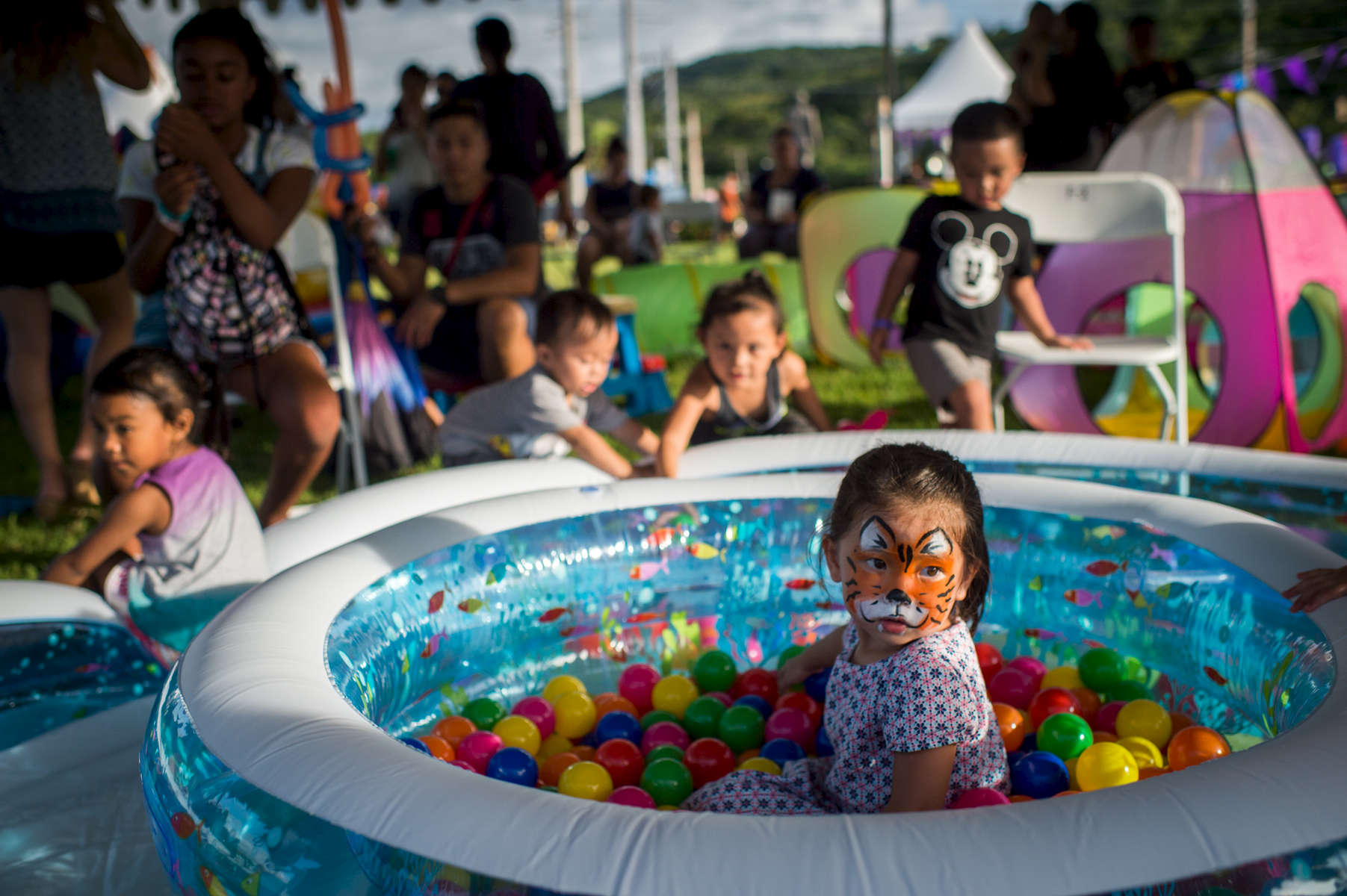 Nina Lee, 4, spends her Saturday at the 3rd Annual Sagua Mañagu Birthing Center celebration carnival set up at the Governor's Complex, Adelup, in Hagåtña, Guam. (Aug 12, 2017)Photo by Nancy Borowick