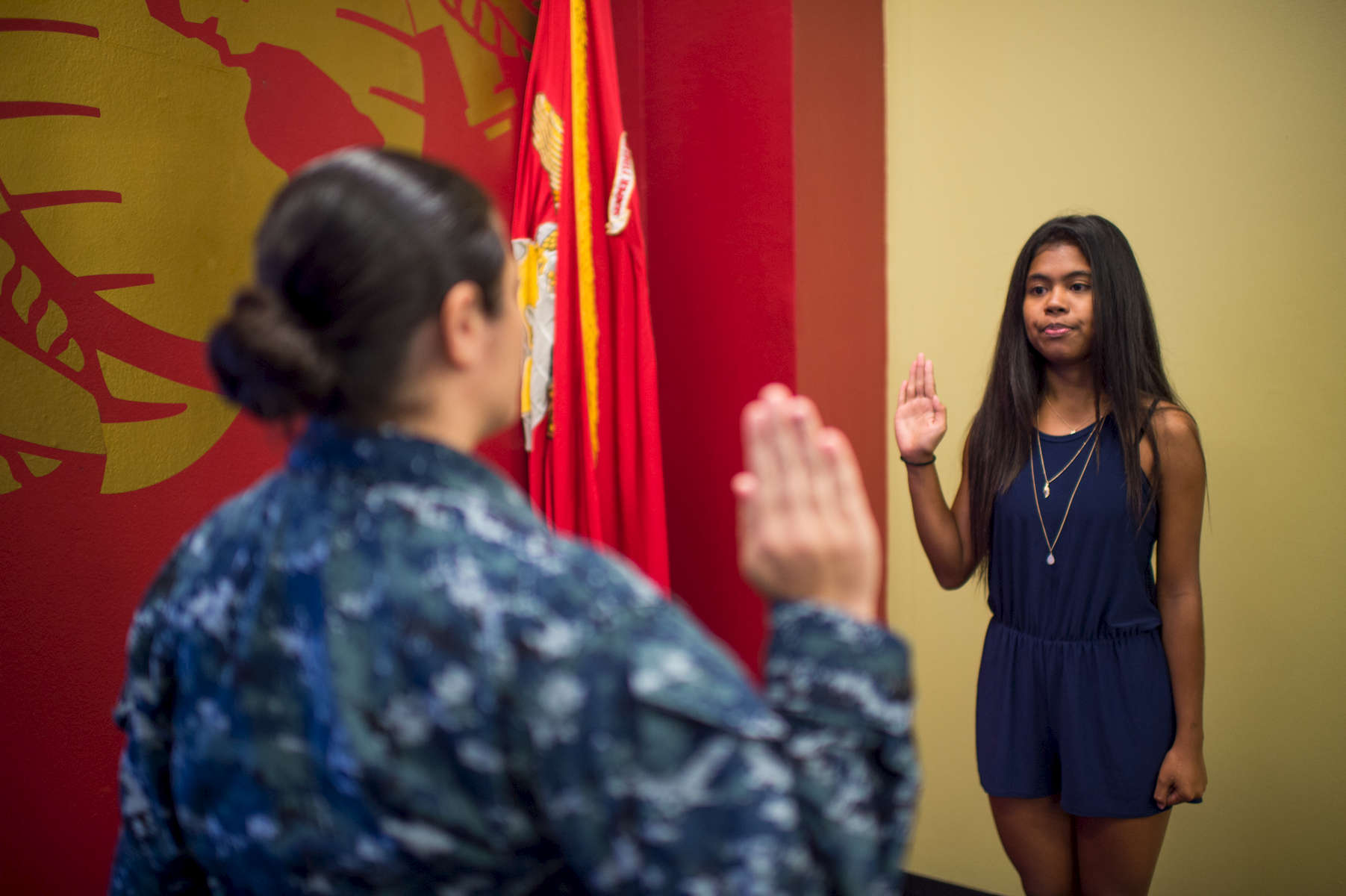 In Hagåtña, the capital city of Guam, Carla Haddock, Lt. Nurse Corp Officer Recruiter for the US Navy swears in 17-year-old Akashamahkeer Weber into the delayed entry program of the United States Marine Corps. She will head to bootcamp immediately following graduation from George Washington Highschool. (Aug 10, 2017)Photo by Nancy Borowick