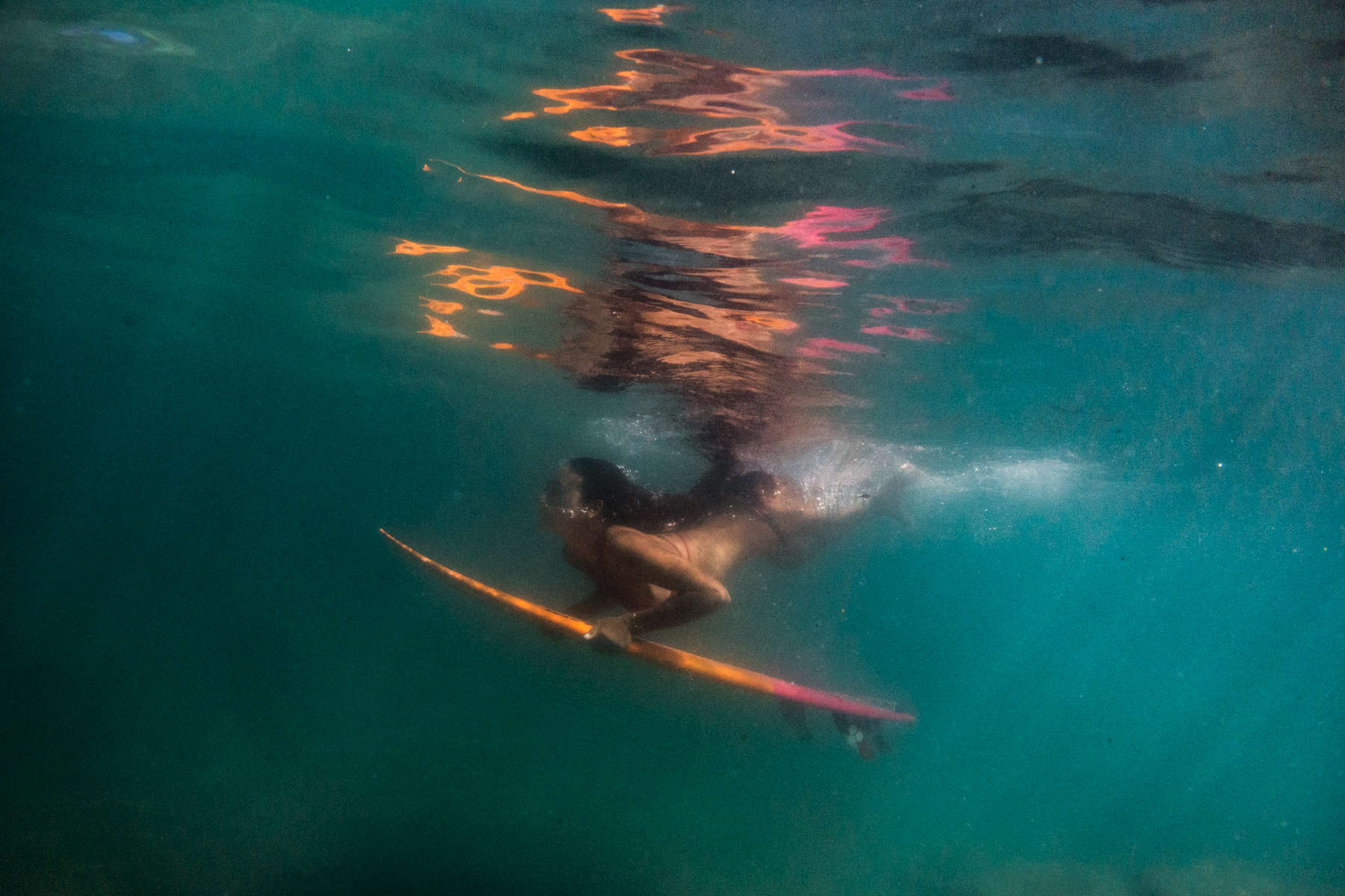 Irie Fitzgerald, 13, junior champion surfer, has lived on Guam her whole life. Even threats made by North Korea to harm her island doesn't keep her from being in the water. (Aug 15, 2017)Photo by Nancy Borowick