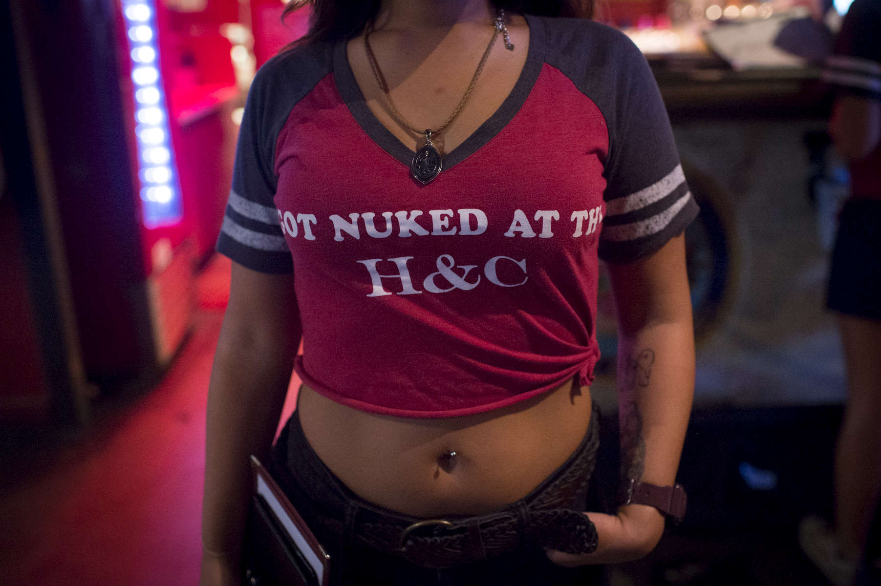 "Some of the waitresses at Guam bar and grill Horse & Cow don t-shirts that read ""I GOT NUKED AT THE H&C."" (Aug 10, 2017)Photo by Nancy Borowick"