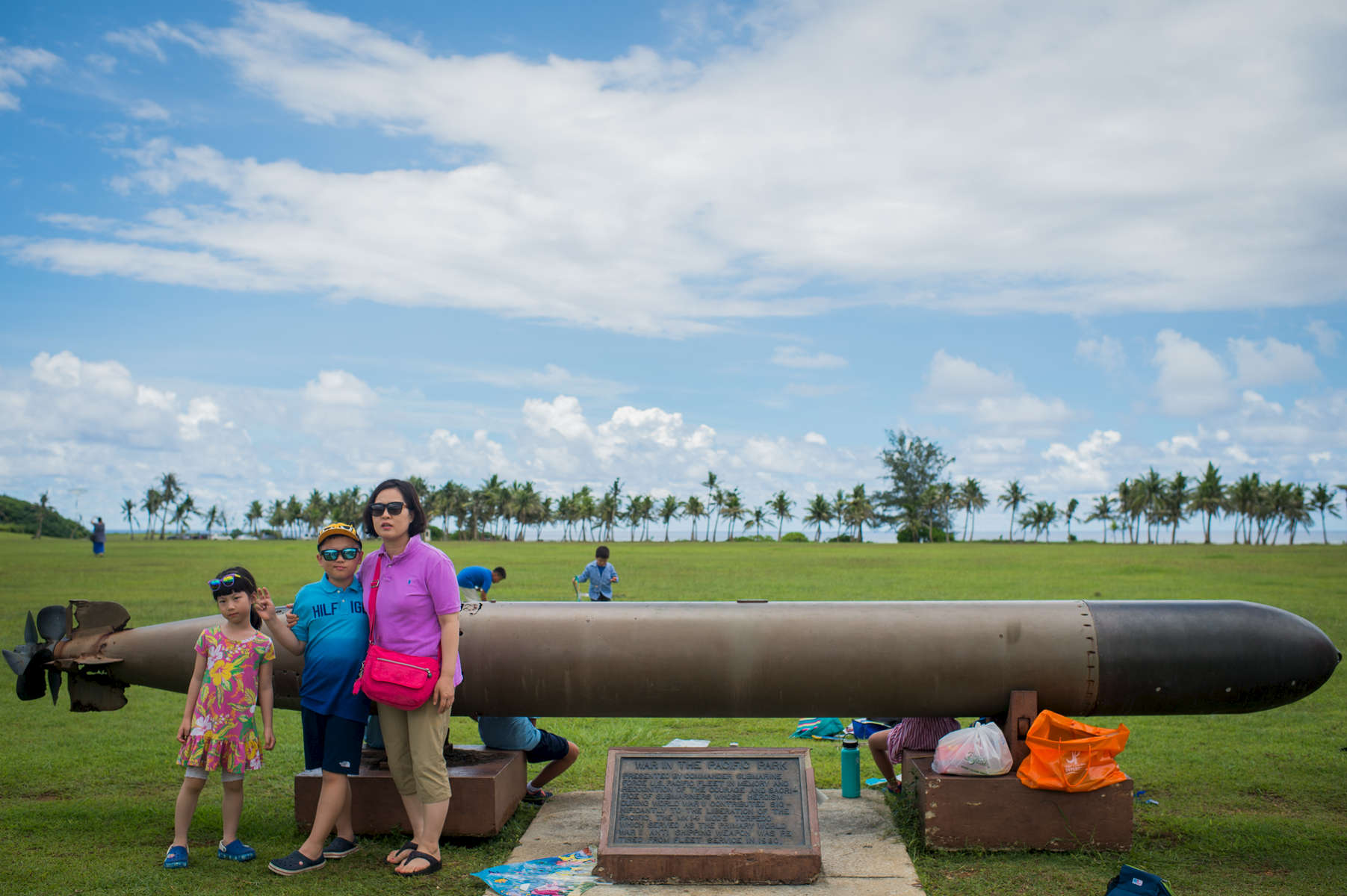 Korean tourists stop by the Asan Beach National Park to snap photos in front of the MK MOD5 Torpedo. This beach was one of the main beaches where U.S. soldiers stormed onto the island during WWII to recapture the land from the Japanese occupation. (Aug 11, 2017)Photo by Nancy Borowick