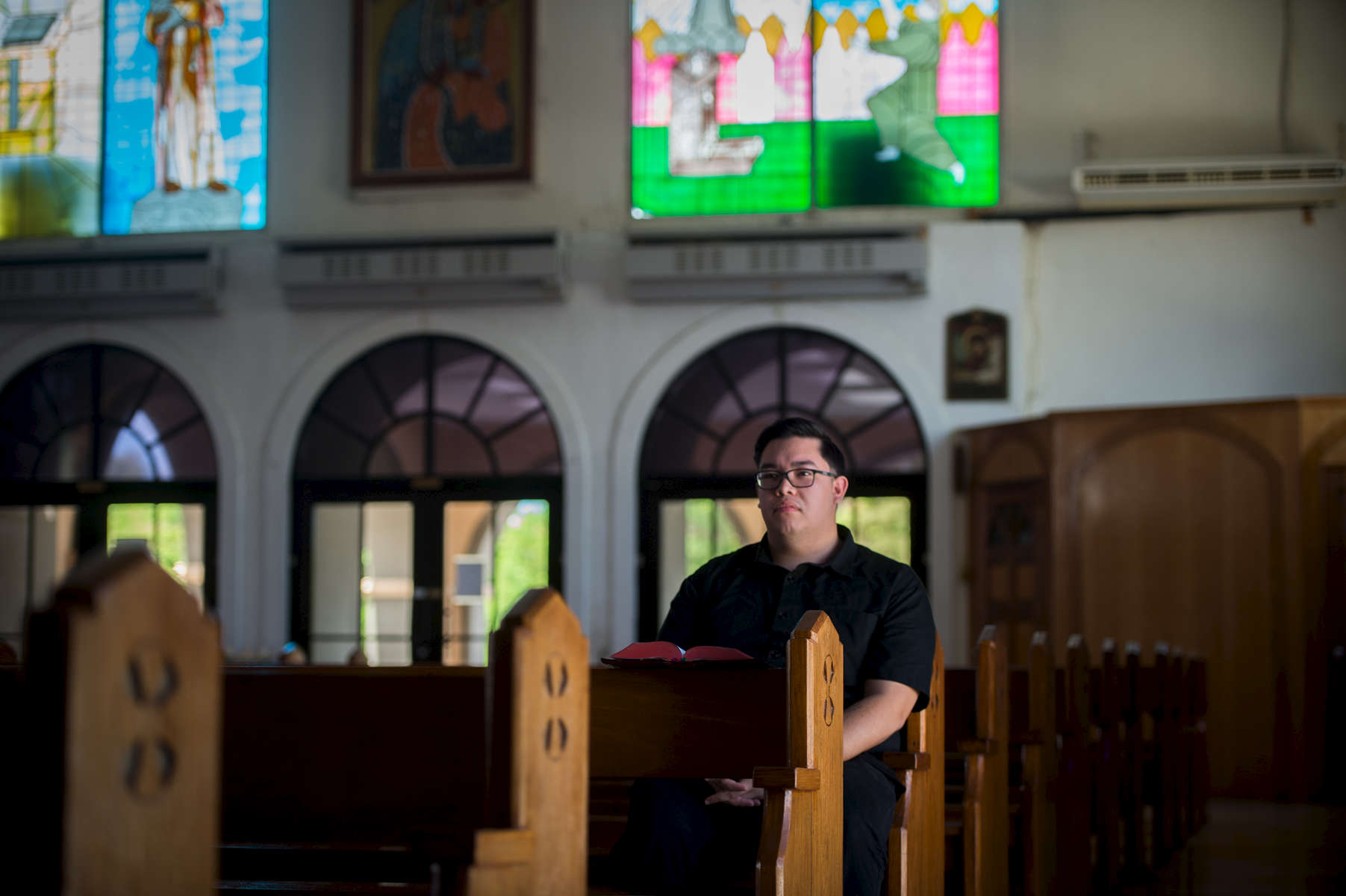 "Sean Rodriguez, 23, a former friar, is working towards becoming a diocesan priest in the Catholic Church. A Guam local, when asked about the recent threats made by North Korea, he said, ""Men shoot missiles. God decides where they land."" (Aug 14, 2017)Photo by Nancy Borowick"