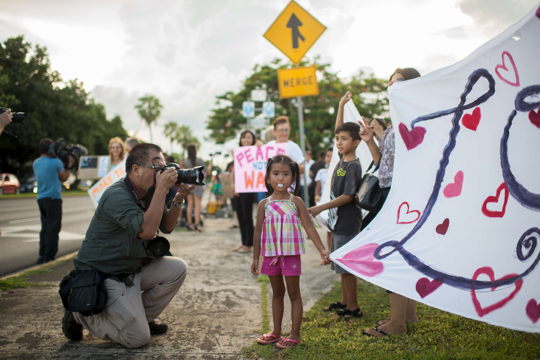 Residents and visitors of Guam rally together at the Maga'lahi Kepuha Loop in Hagatna in a call for peace amidst dangerous threats of war coming from North Korea. Five-year-old Edyn Perez joins in the movement. (Aug. 14, 2017)Photo by Nancy Borowick