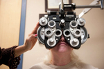Dr. Gwen Gnadt uses a Phoropter on patient Cindy Fagan to determine the proper eyeglass prescription for her during an eye exam at Eye Vision Associates in Lake Ronkonkoma. (Mar. 1, 2012) Photo by Nancy Borowick