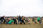 During the annual Boot Camp at East Islip Middle School in Islip Terrace, students on the green {quote}platoon{quote} challange their classmates in tug-of-war. (Mar. 2, 2012) Photo by Nancy Borowick