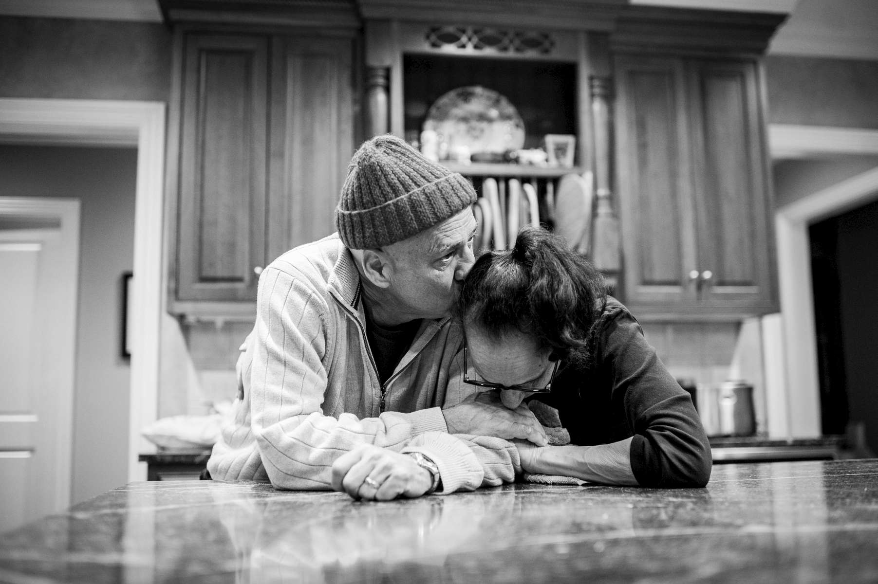 Howie and Laurel share a quiet moment alone in the kitchen after a long day of treatment. No longer working, their daily activities revolve around doctors appointments. Chappaqua, New York. January, 2013