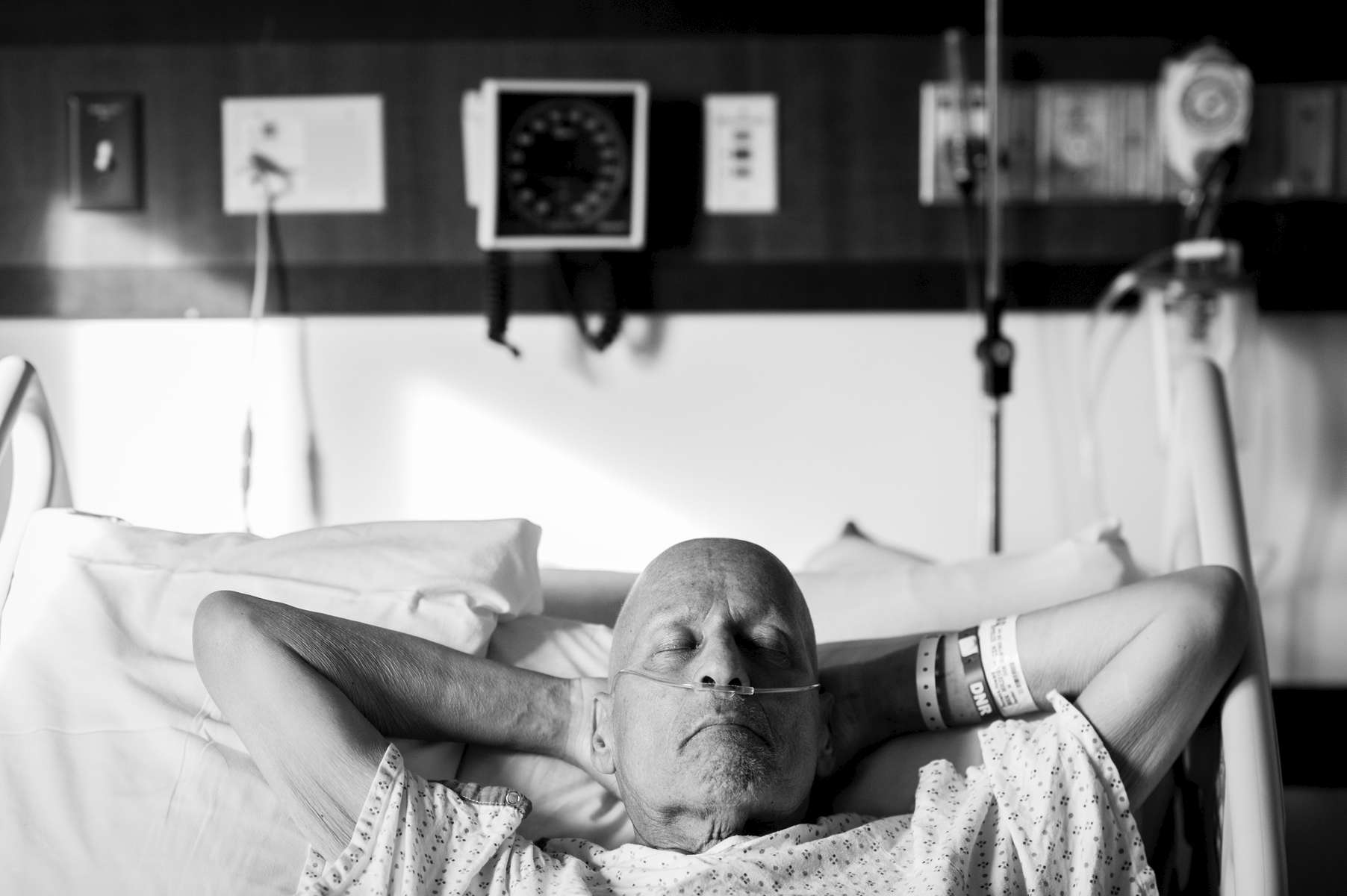 The air felt strange at the hospital that day. This photograph was taken moments after the nurse attached a Do Not Resuscitate bracelet to my father's left wrist. The decision had been made, and if the time was to come, Dad got to make that decision for himself. This brought a sense of relief, in a way, because the pain was almost over, because he was no longer living a life of quality.