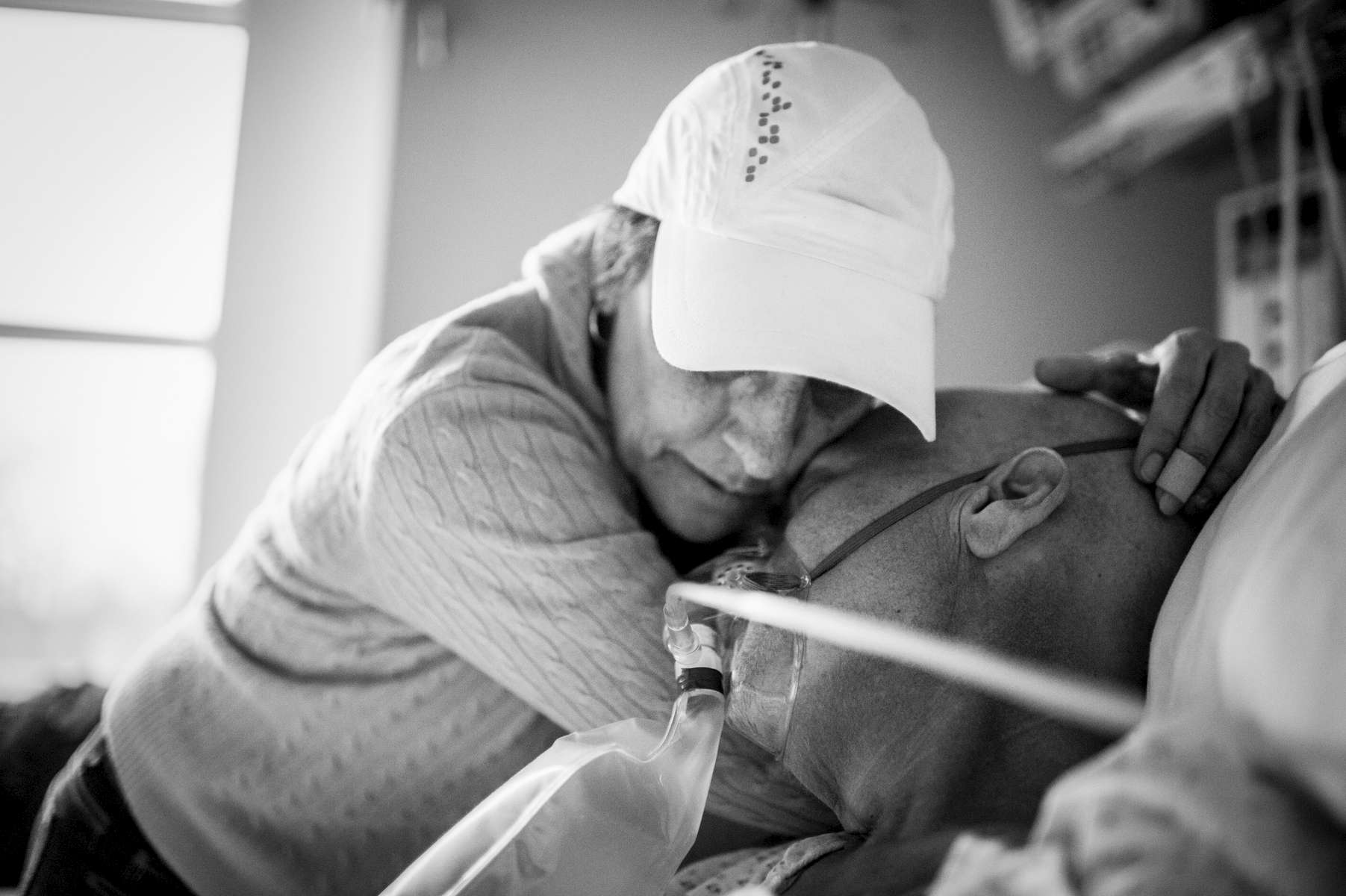 Laurel Borowick embraces husband Howard in the ICU after hearing news that the cancer had spread and there was little the doctors could do besides make him as comfortable as possible. Greenwich, Connecticut. December 2013.
