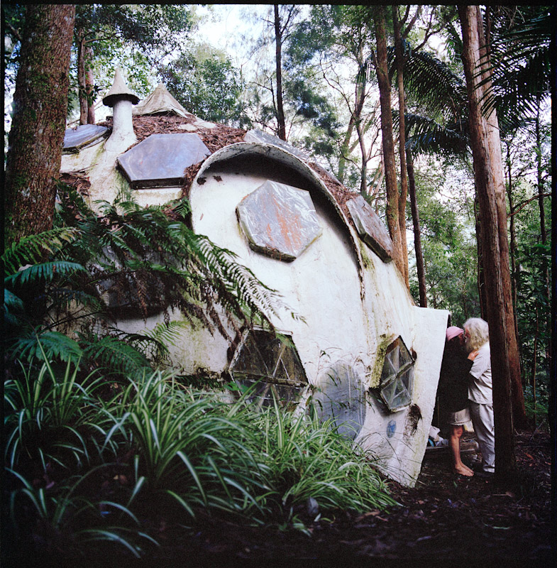Kali has been living in this hand built geodesic dome since the 70's. She now lives here with James her partner of almost 30 years. The dome is in a remote part of land and the couple have to be fit and nimble to navigate the challenging path from their work space to their dome which includes crossing hand made wooden bridges, scaling steep mossy rocks, cliff sides that weep water, and ducking through overgrown tunnels of lantana.