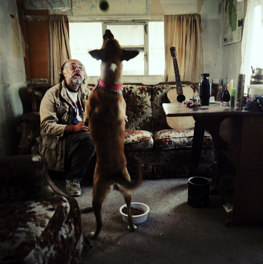 James playes with his dog Spider Monkey in his trailer.