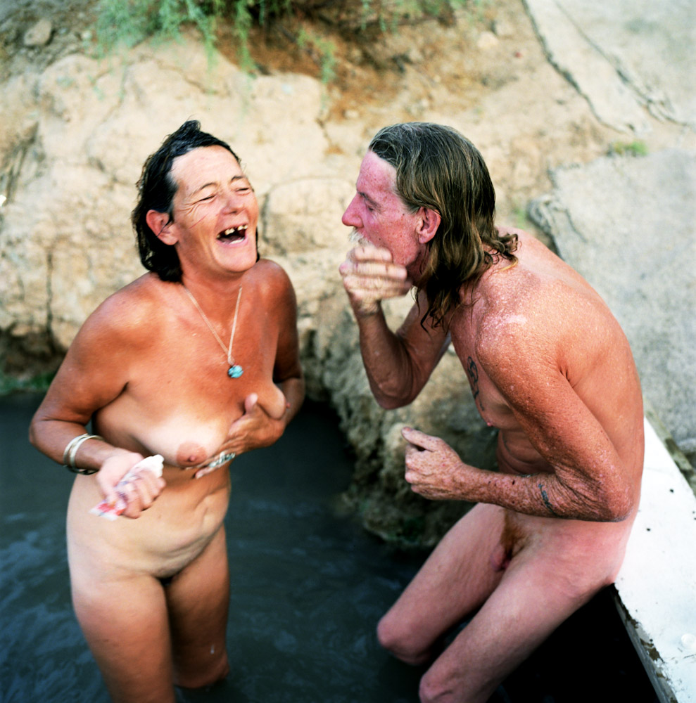 Carol and Gary bathe in the hot spring. There is no access to public water in Slab City so the residents use the local hot spring, or the near by canal to bathe.