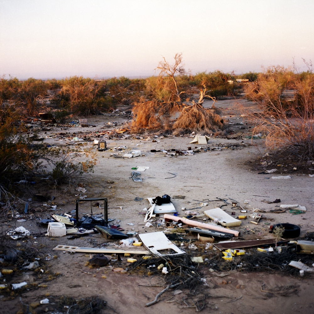 With no access to waste disposal, people dump their trash in the surrounding area.