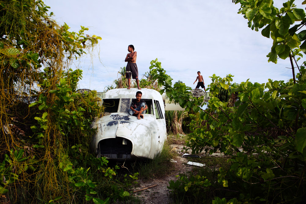 children play on an abandoned plane at the Tarawa airport.