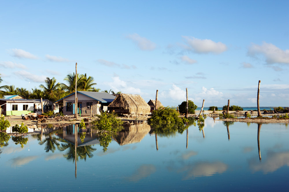 Tebikenirkoora Village, Tarawa is an area that has been particularly affected by the rising sea level, with mature palms dying from Salt poisoning and people being forces to relocate their homes or swim home at high tide.