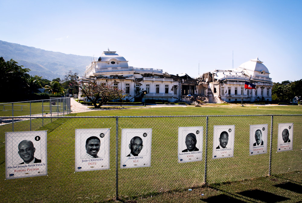 Campaign posters line the security fencing around the Presidential Palace.