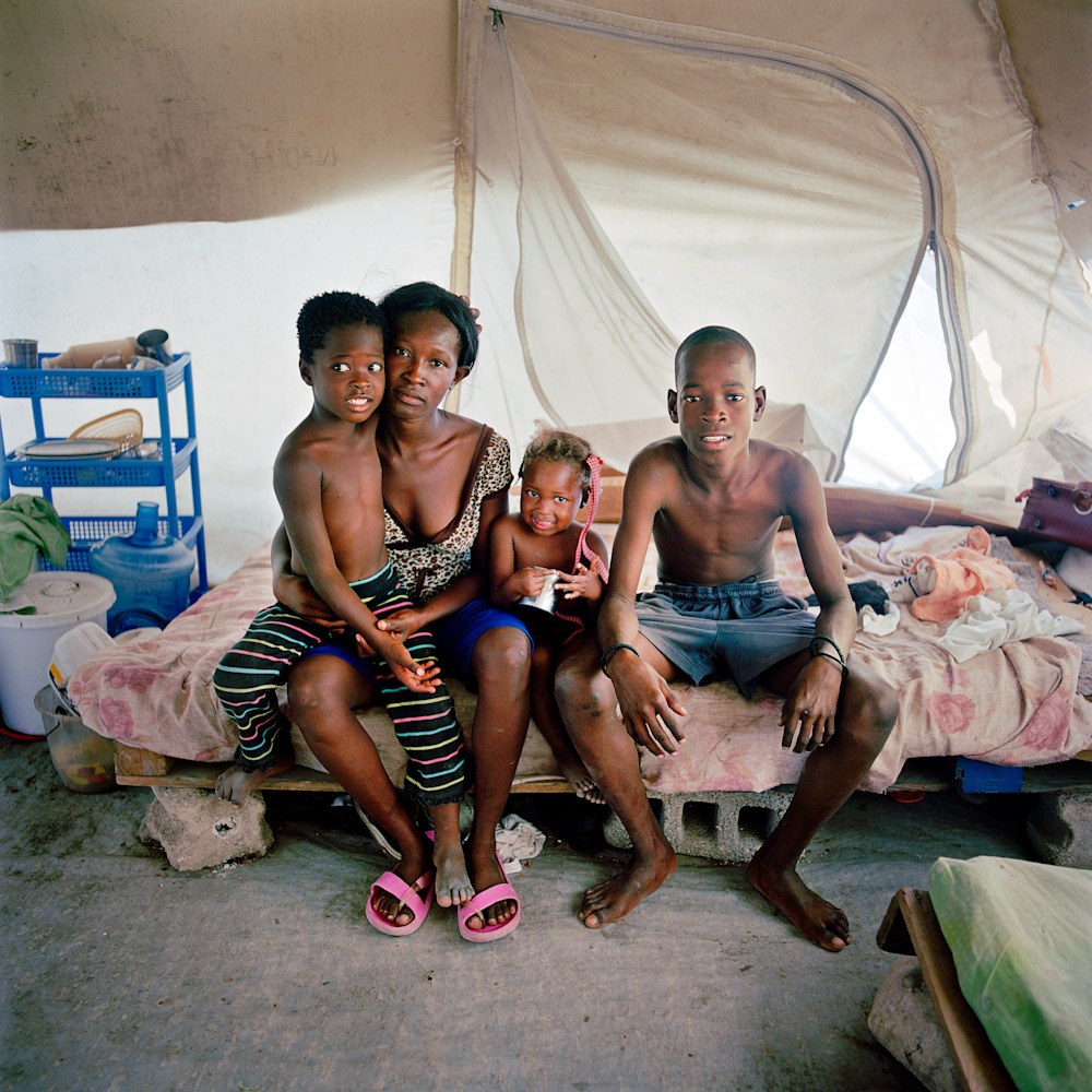 family home petionville club life in s tent cities this single mother raises her young family in a tent city community after her house was