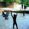 For the children playing in the cleaner parts of the canals is light relief from the intense heat of the day. They swim despite the fact that there is now the added threat of Cholera in the waterways.