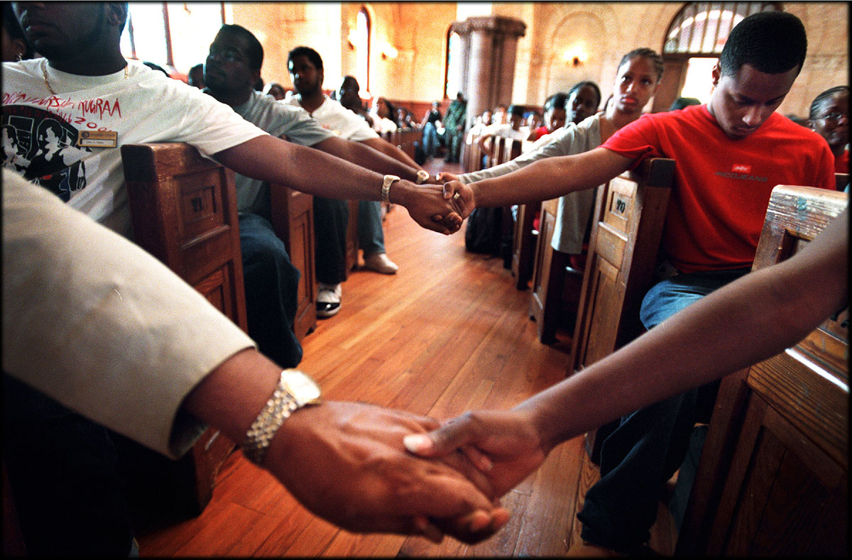 Hampton University students and faculty members hold hands and pray for the victims of September 11 terrorist attacks.