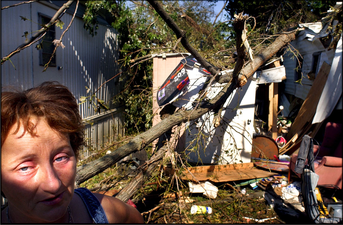 """This is all I have,"" Tina Turlington sobs out. Her mobile home was demolished as Hurricane Isabel swept Hampton Roads area in Virginia. Tina, her disabled husband and a teenage son are one of the 7,851 Virginia families, who were forced out of their homes by the hurricane."