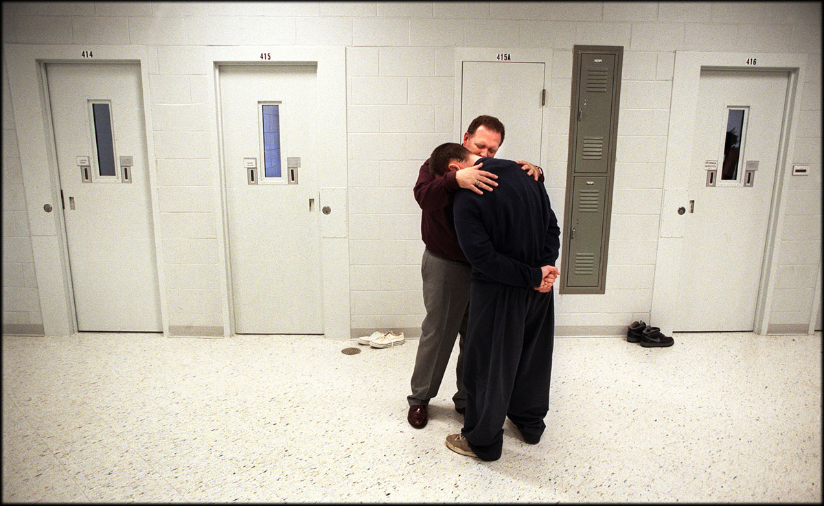 Jack Smith, chaplain of Southeastern Correctional Ministry, comforts and prays with a teenage resident at Middle Peninsula Juvenile Detention Center. For 20 years, the ministry has reached out to those in jails on and around the Peninsula.