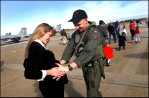 """Ty Frautschi, an F/A-18 Hornet Pilot, greets his wife, Tiffany, 8-month pregnant, as he and other members of the """"Sunliners"""" of Strike Fighter Squadron 81 returned from a six-month deployment."""
