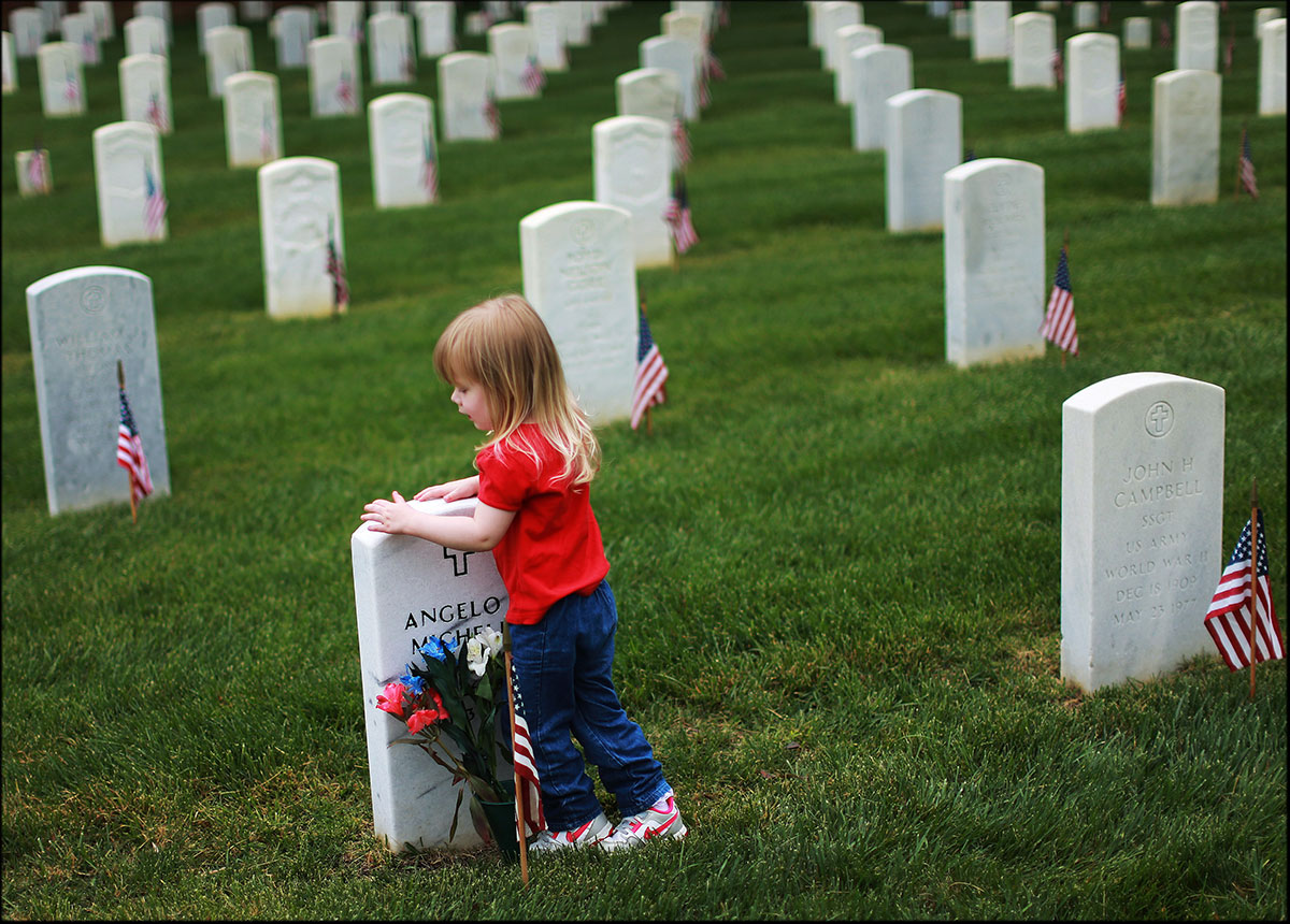 Victoria Worsham, 3, visits her great grand father, Angelo F. Michelli, who died in action during Vietnam War, at Seven Pines National Cemetery in Sandston on Memorial Day.