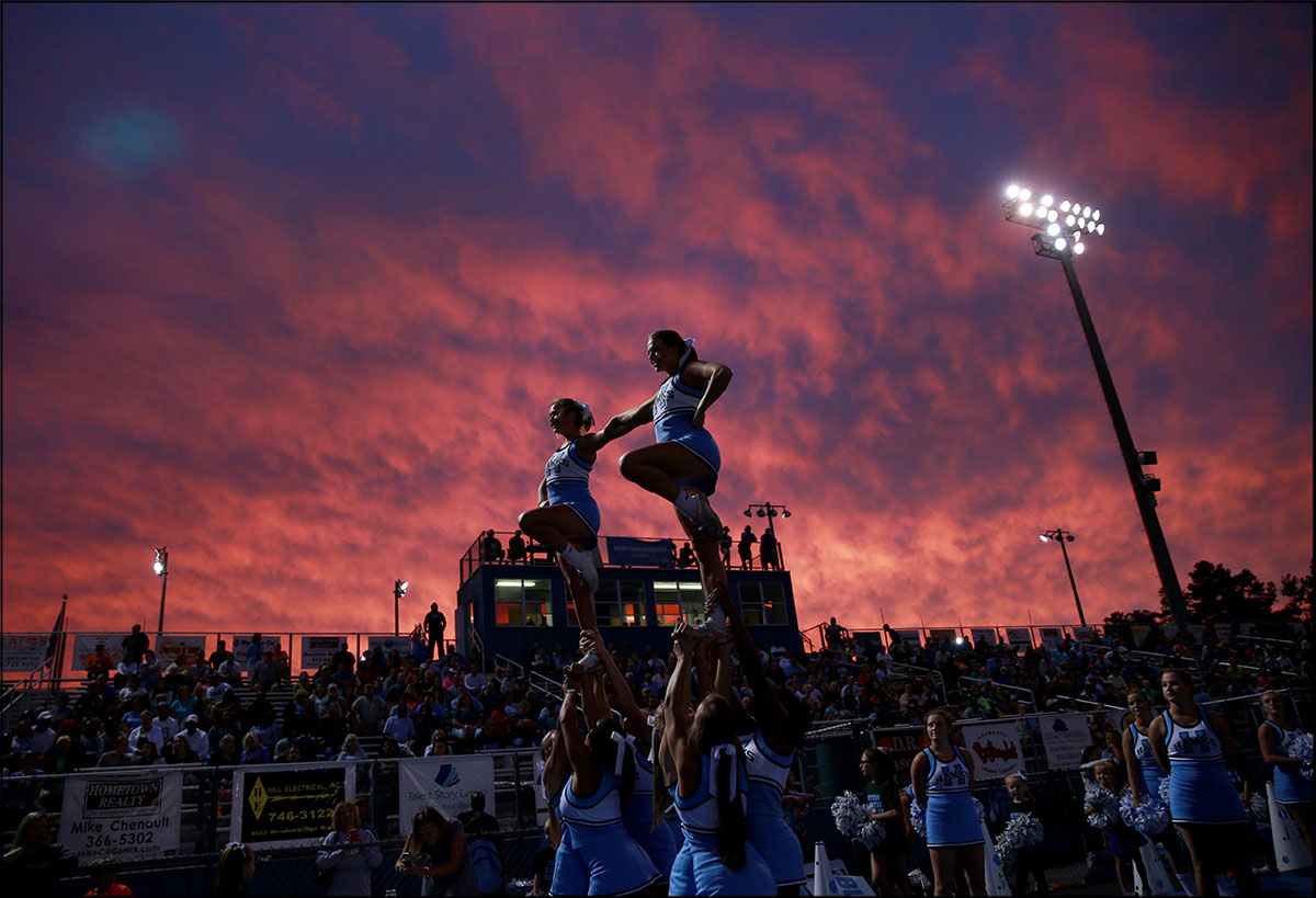 Hanover High School cheerleaders perform with sunset as tropical storm Hermine approach the area.