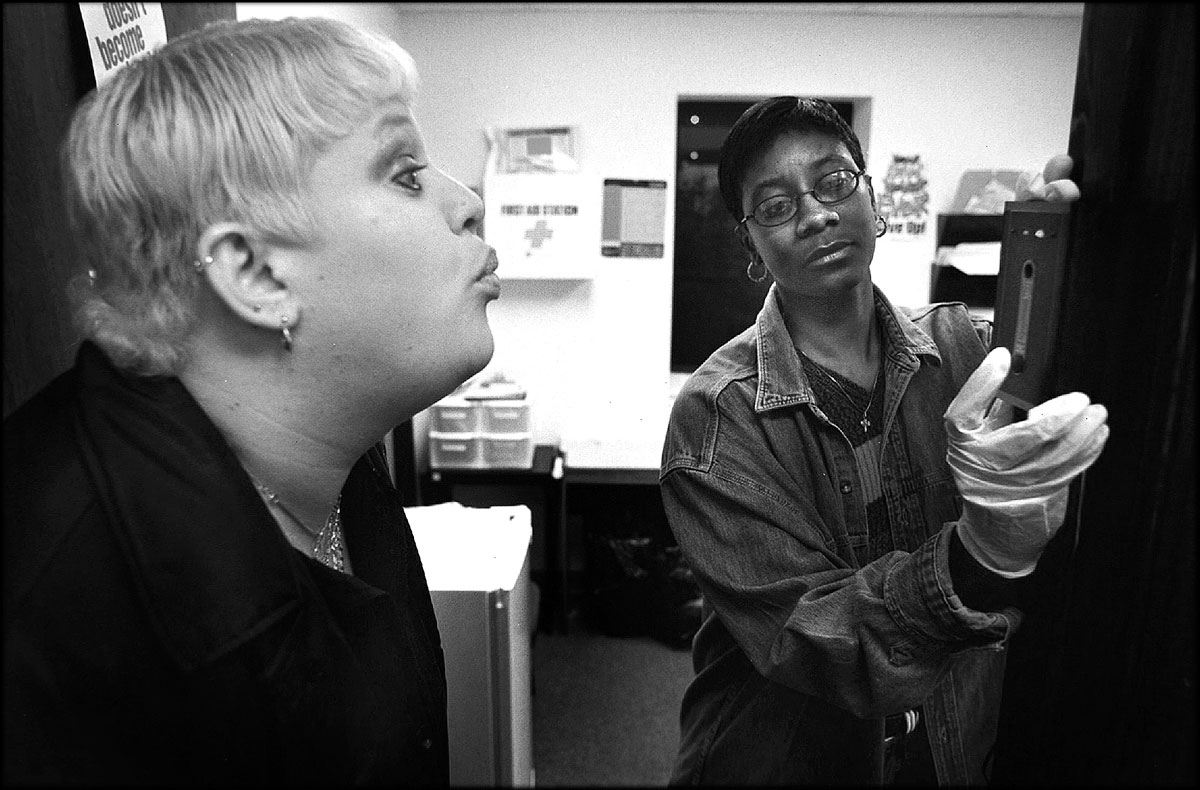 Jennifer is screened for alcohol with a breathalyzer by Denise Sherrod, a drug court staff member, before the group meeting. The program's participants are prohibited from alcohol as well as drugs.