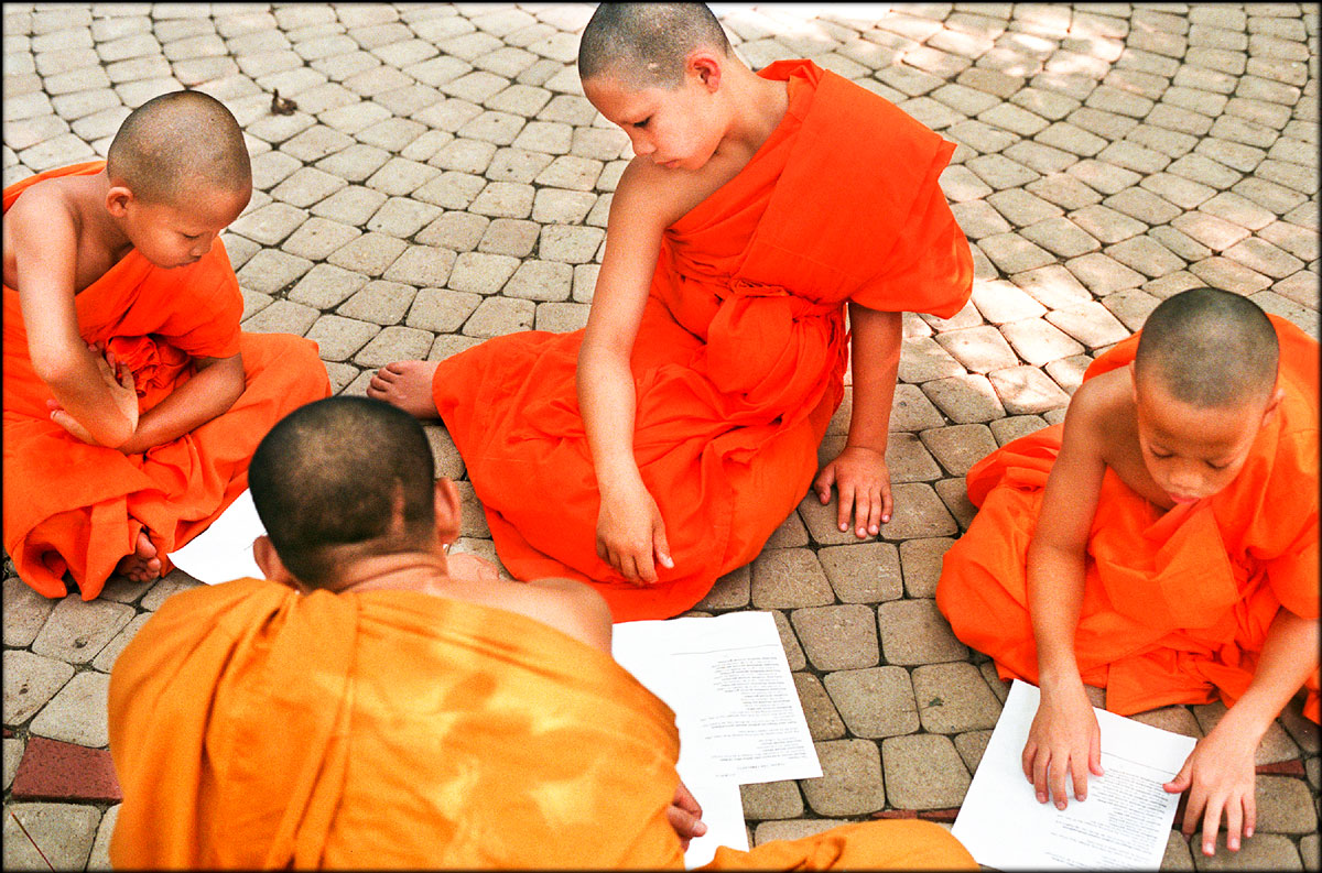 Am Ritmaha, Keith Chainam and Steven Younagul learn and memorize the ten precepts in Pali, the ancient Indian language spoken by Buddha in the 5th century B.C. Methawee Bhikkhu, a senior monk, helps them with their lessons.
