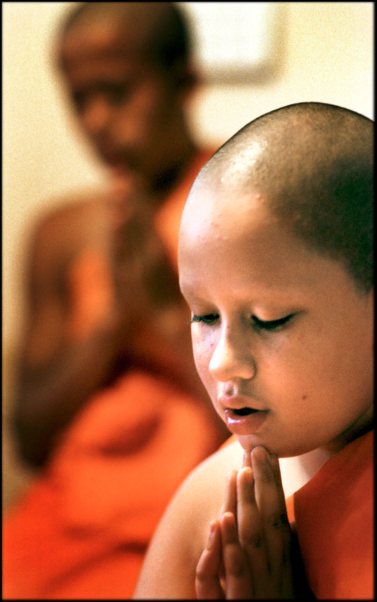 Joseph Bray chants and meditates during evening training. The novice monks chant and meditate three times a day in Pali and in English.