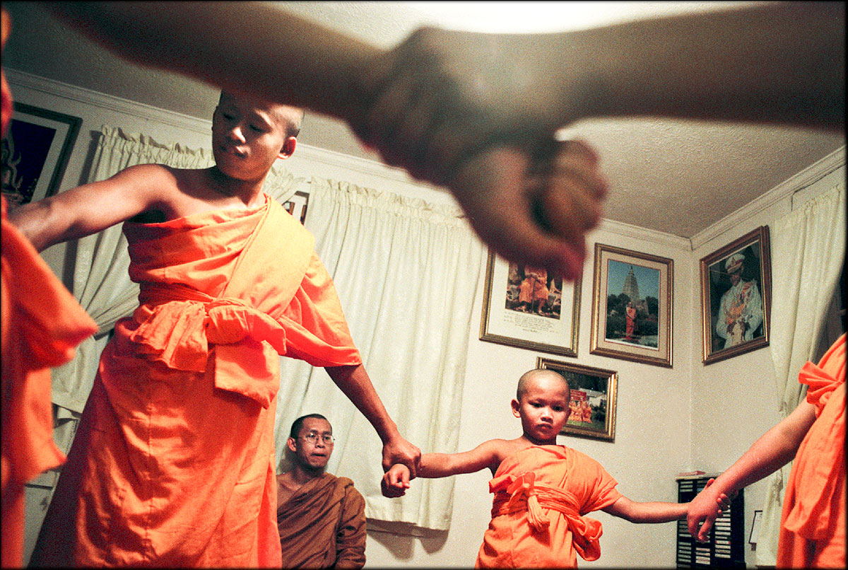 Phramaha Putthachak Buddhisaro, a senior monk, keeps an eye on James Rimnongrua, left, Am Ritmaha and other young monks as they learn harmony.