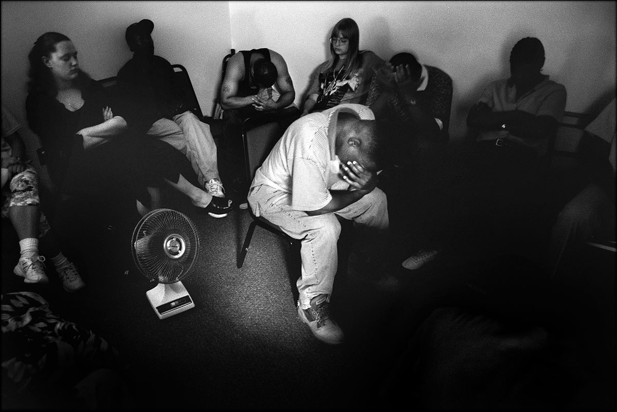 Drug Court counseling sessions are sometimes quiet and reflective, sometimes angry and loud. Vernon, center, and other Drug Court participants use meditation time during the session.