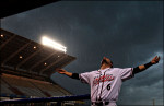 Richmond Flying Squirrels' Andrew Susac opens arms to feel rain as a severe thunderstorm approaches to area and stopped the baseball game.