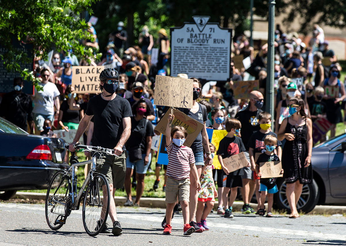 Children, parents and others chant for a Black Lives Matter protest.