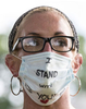 A protester wears a face mask with her message.