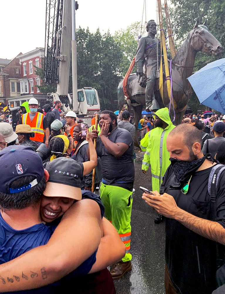 The crowd celebrate as the Stonewall Jackson statue was being removed.