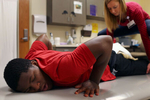 Edward gets his physical therapy from Lindsay Derenthal, a physical therapist, at Sheltering Arms Physical Rehabilitation Centers, in Richmond. As Edward's waist down is paralyzed by gun shots, his posture is unbalanced by weak muscle.