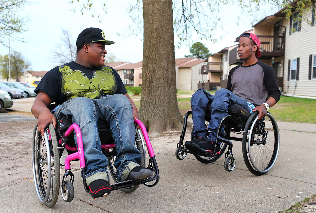 "Edward, left, and Andre Seabrook, show off what they can do with their wheelchairs as Edward visits his friend, Andre, in Richmond. They met each other at VCU rehabilitation center as they both were shots on the same day but not related crimes, which caused paralysis for both from their waist down. ""When I heard his story, it made me feel better about my story. So I won't be the only one going through my situation, ""Edward said of Andre."