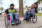 """Edward, left, and Andre Seabrook, show off what they can do with their wheelchairs as Edward visits his friend, Andre, in Richmond. They met each other at VCU rehabilitation center as they both were shots on the same day but not related crimes, which caused paralysis for both from their waist down. """"When I heard his story, it made me feel better about my story. So I won't be the only one going through my situation, """"Edward said of Andre."""