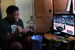 Edward plays Xbox basketball game at his home in Richmond. Edward likes to play the game as this is only way he can feel like playing sports, which he loves. His mom, Lawanda Booker, said that he used to be very outgoing and athletic kid but his medical issues keep him inside.