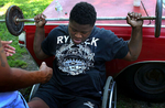 Edward exercises with the help of Rodney Debro, a neighbor, at Debro's backyard in Richmond. To prepare his spinal fusion surgery, Edward tried to lose his weight and build the muscle.