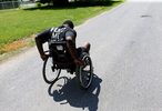 Edward pushes himself to home after his workout at his neighbor's home in Richmond. To prepare his spine surgery, Edward tried to lose his weight and build the muscle.