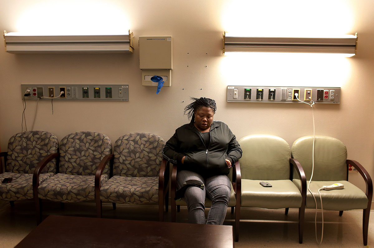 Lawanda Booker waits as her son, Edward Miller, goes through 13-hour spinal fusion surgery to treat his curved spine at Shriners Hospitals for Children in Philadelphia. As Booker has to take care of Edward's medical issues and other needs, she has to stop working her job as a taxi driver, which caused difficult financial issues for the family.