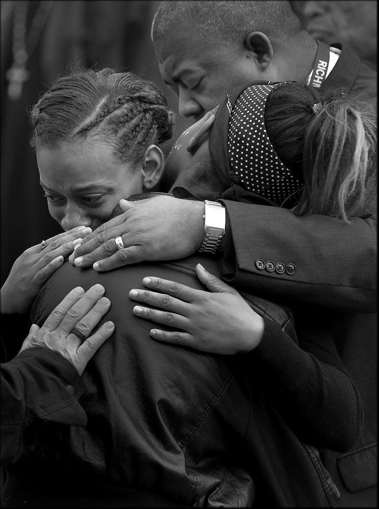 Shaqwanna Boisseau, facing, comforts her cousin, Kalesha Jones, 11, best friend of Amiya Moses, during a vigil. Amiya, the 12-year-old, was killed at her friend's apartment by a random shooting.
