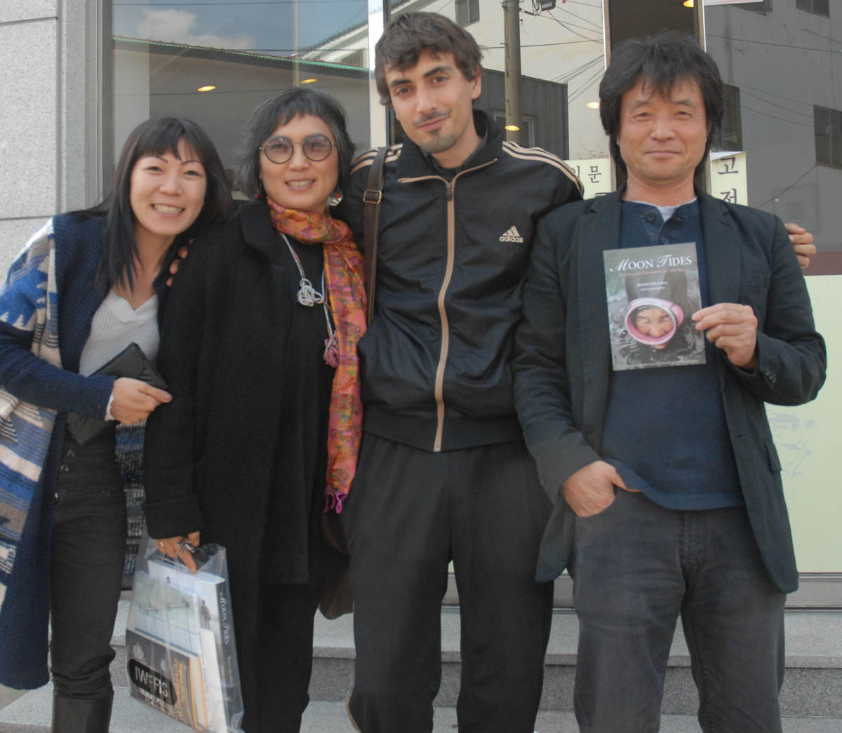 Left to right: filmmaker Jane Jin Kaisen, Ahn Hye-kyoung (Art Space C), filmmaker Guston Sondin-Kung and artist Koh Gil-chun