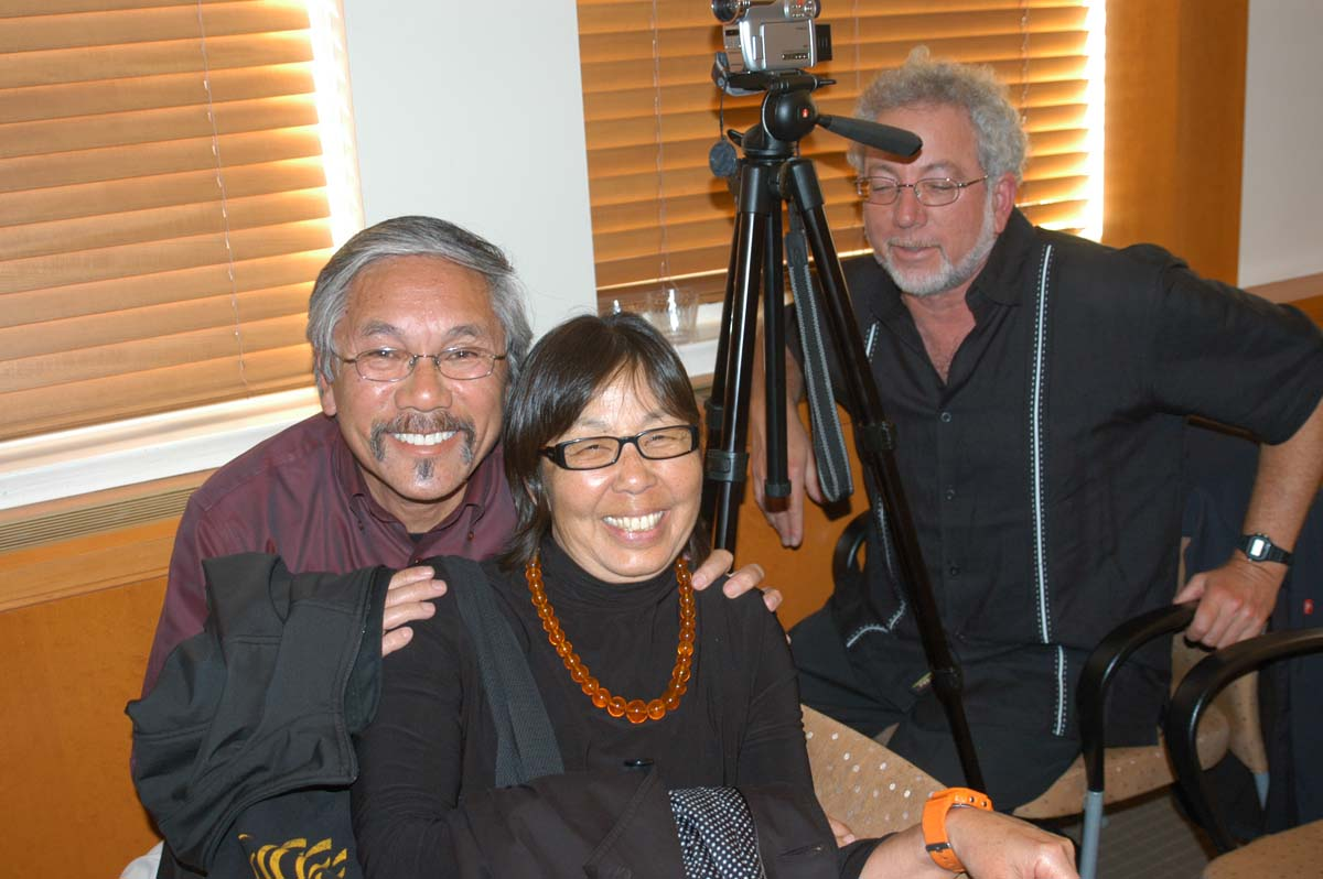 Emery Woo, Denise Woo and event videographer, Norm Gusner.