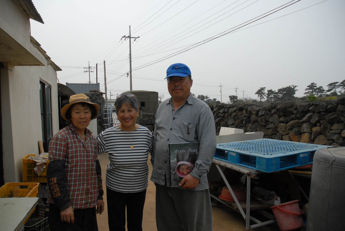 Left to right: Kang Deok-kyo, haenyeo; author and Kang's son, Im Myeong-ho, founder of Haenyeo School in Gwideok village.